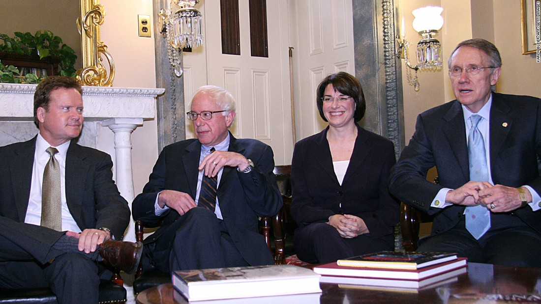 Then-senator-elect Bernie Sanders meets with 2006 Senate Minority Leader Harry Reid (right) on November 13, 2006, in Washington, D.C. On his left is then-senator-elect James Webb and on his right is then-senator-elect Amy Klobuchar.
