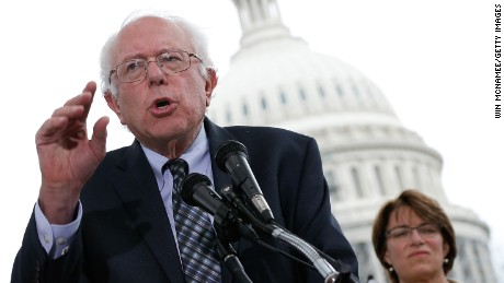 On September 8, 2014, Sanders speaks from outside the U.S. Capitol at a press conference where members of Congress discuss a joint resolution proposing an amendment to the Constitution of the United States relating to contributions and expenditures intended to affect elections.