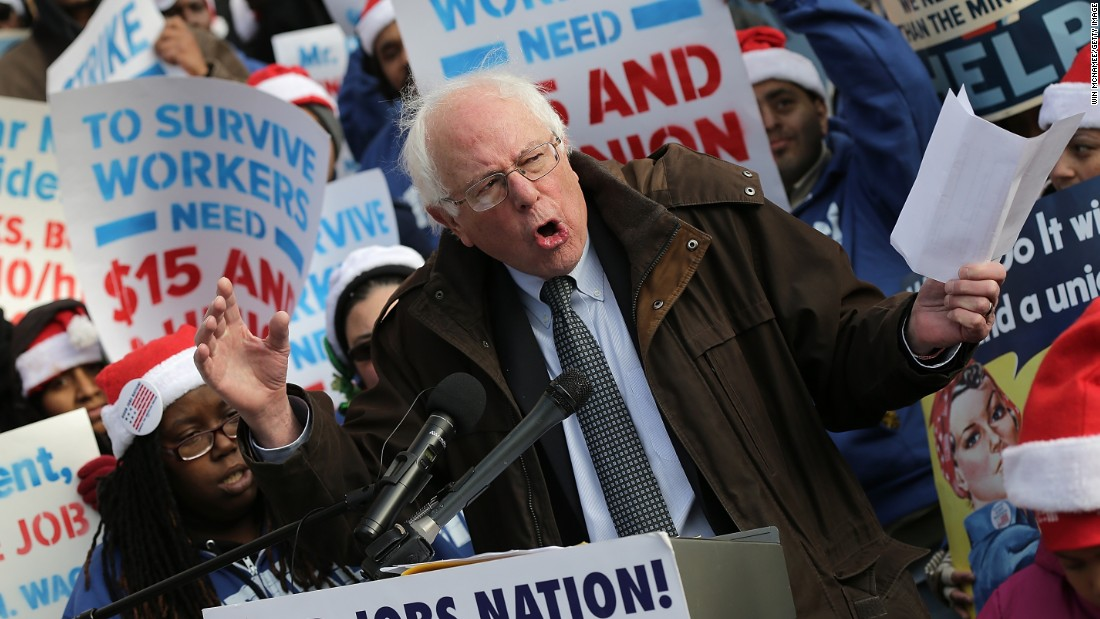 Sanders speaks to low-wage federal contract workers during a protest where the workers demanded presidential action to win a wage increase to $15 an hour on December 4, 2014, in Washington.