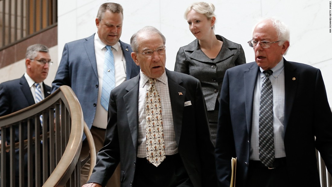 Sanders, left, and Sen. Charles Grassley of Iowa arrive with other senators for a briefing at the U.S. Capitol on September 11, 2014, by military and intelligence officials for members of the U.S. Senate on the White House strategy to combat ISIS.