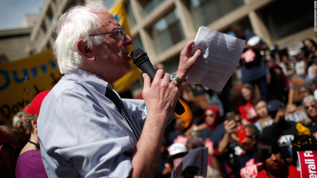 "Sanders speaks to protesters taking part in the ""Don't Trade Our Future"" march on April 20."