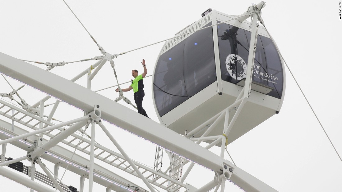 Daredevil performer Nik Wallenda walks untethered along the rim of the Orlando Eye, the Florida city's new 400-foot observation wheel, on Wednesday, April 29. Click through the gallery for other Wallenda stunts through the years.