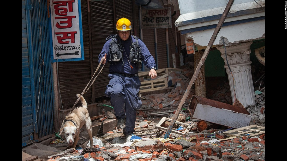 "A member of the Los Angeles County Fire Department guides his sniffing dog through a collapsed building in Kathmandu, Nepal, on Thursday, April 30. A magnitude-7.8 earthquake centered less than 50 miles from Kathmandu <a href=""http://www.cnn.com/2015/04/28/asia/nepal-earthquake/index.html"">rocked Nepal with devastating force</a> Saturday, April 25. The earthquake and its aftershocks have turned one of the world's most scenic regions into a panorama of devastation, killing and injuring thousands."