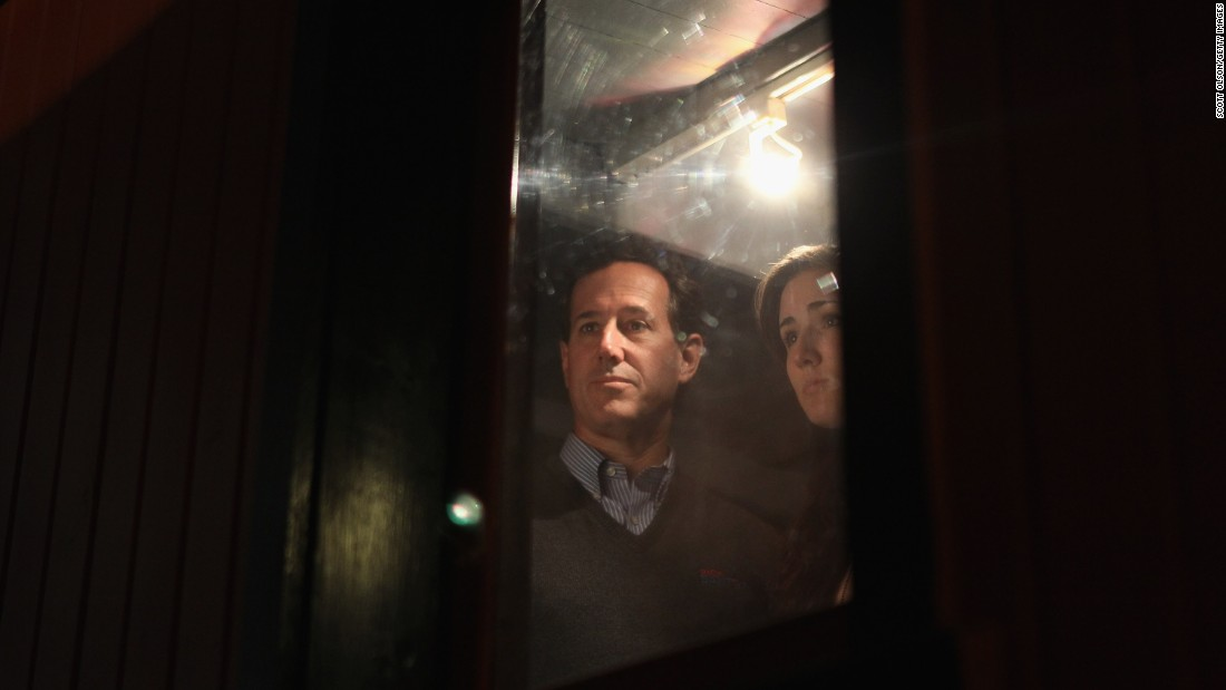 Santorum tours a vintage train car with his daughter Sarah during a campaign stop at the National Railroad Museum on April 1, 2012, in Green Bay, Wisconsin.