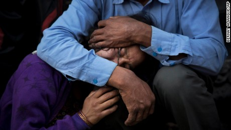 A woman is comforted during the funeral of her mother, a victim of Saturday's earthquake, in Kathmandu, Nepal, on Friday, May 1.
