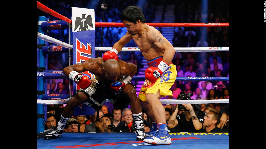 Manny Pacquiao throws a right at Floyd Mayweather on Saturday, May 2.