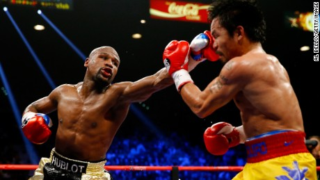 Floyd Mayweather Jr. throws a left at Manny Pacquiao.