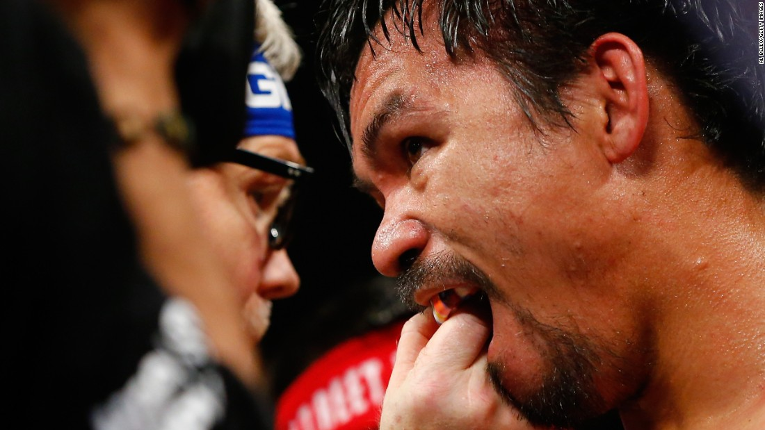 Trainer Freddie Roach adjusts Manny Pacquiao's mouth guard at the MGM Grand Garden Arena in Las Vegas. <br />.