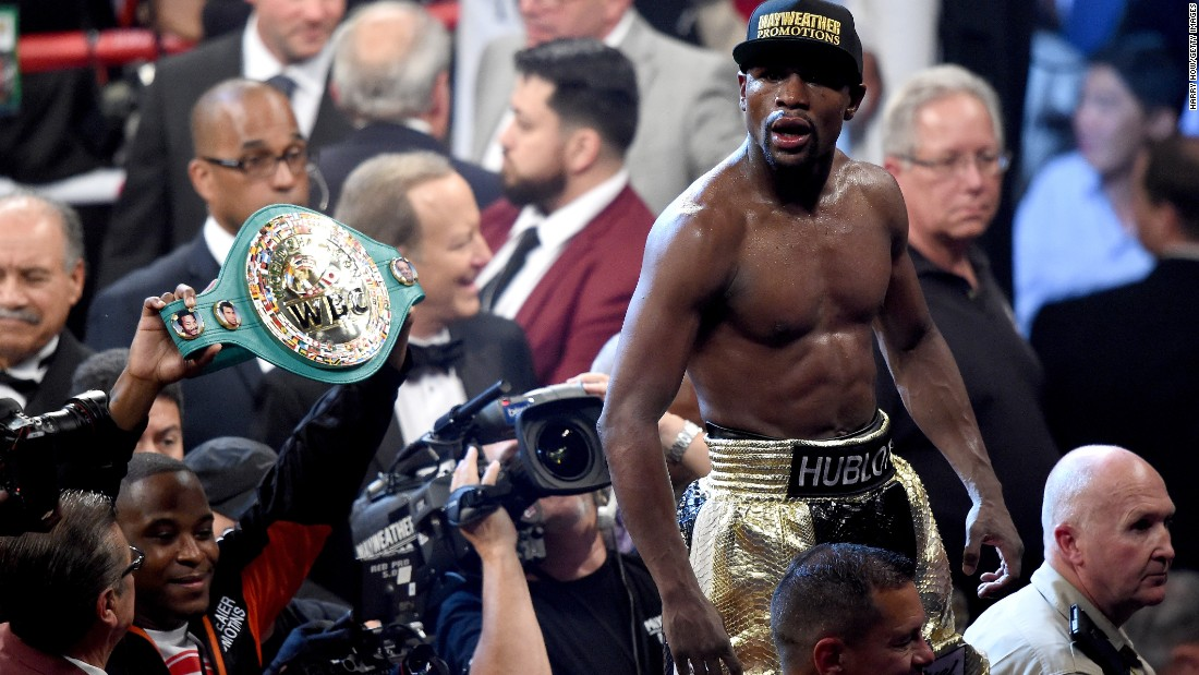 Floyd Mayweather won the World Boxing Organization's title and retained the World Boxing Association and World Boxing Council belts.