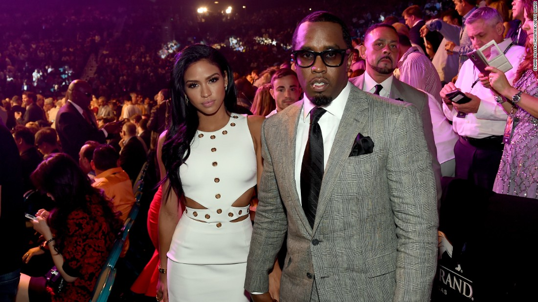 "Model Cassie Ventura, left, and Sean ""Diddy"" Combs pose ringside."