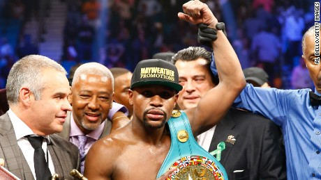 LAS VEGAS, NV - MAY 02: Floyd Mayweather Jr. celebrates the unanimous decision victory during the welterweight unification championship bout on May 2, 2015 at MGM Grand Garden Arena in Las Vegas, Nevada. (Photo by Al Bello/Getty Images)