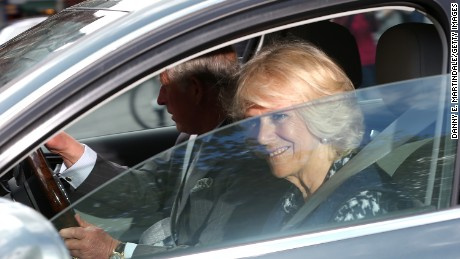 Charles, Prince of Wales, and Camilla, Duchess of Cornwall, leave Kensington Palace the day after Saturday's royal birth.
