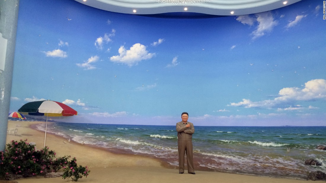 A life-size statue of late leader Kim Jong Il stands at the entrance to a new water park in Pyongyang. Visitors bow to pay their respects.