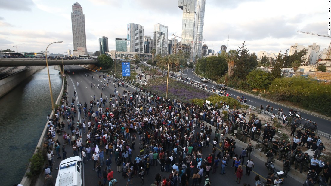 Protestors block the Ayalon freeway in Tel Aviv during the demonstration.