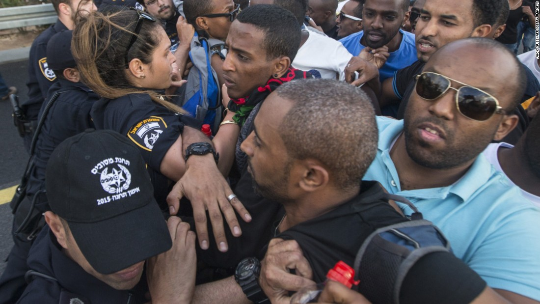 Protestors scuffle with Israeli security forces.