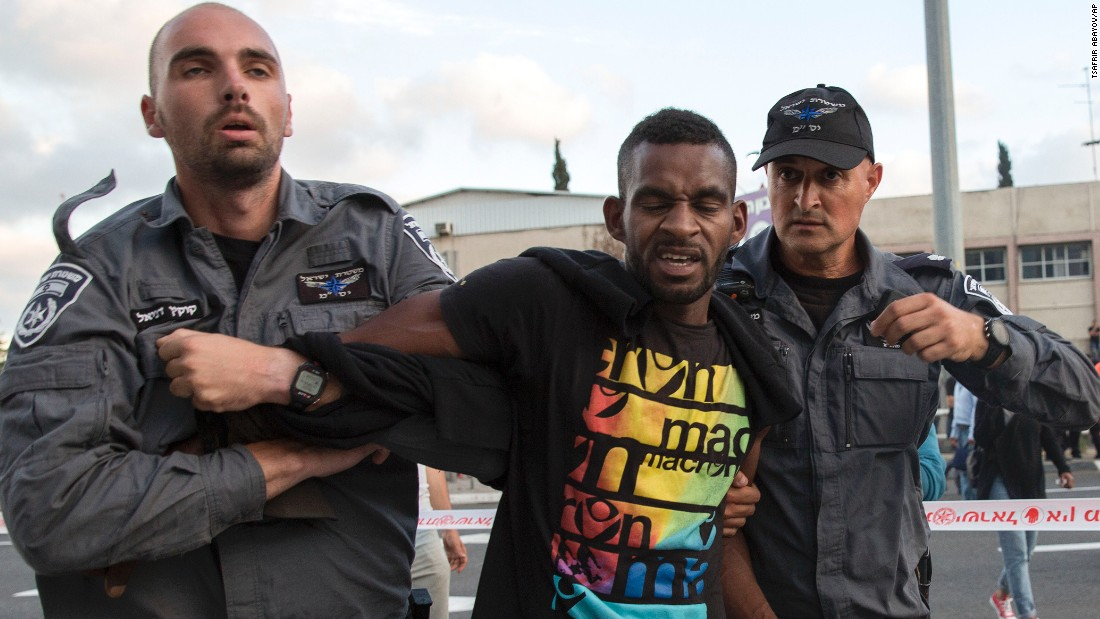 Israeli police officers detain an Israeli Ethiopian.
