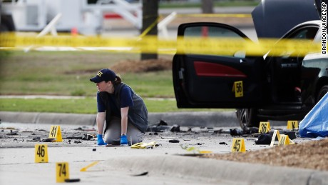 An FBI crime scene investigator documents the area outside the Curtis Culwell Center in Garland, Texas, on Monday, May 4.