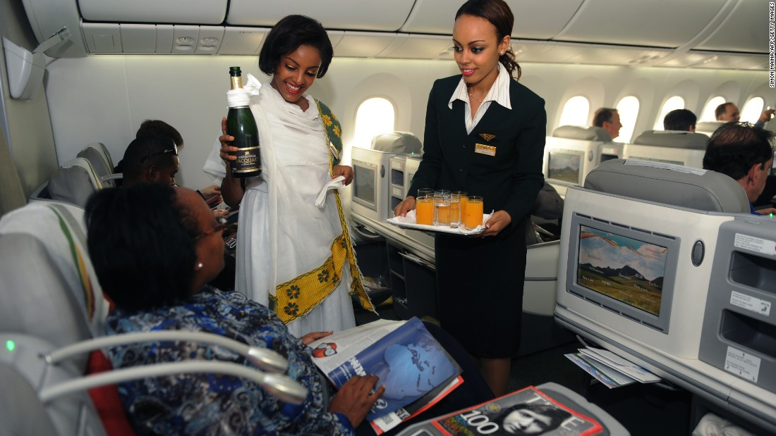 Flight attendants serve beverages aboard an Ethiopian Airlines 787 Dreamliner on a flight to Jomo Kenyatta International Airport in Kenya's capital of Nairobi on April 27, 2013. The carrier was the first airline in Africa to fly the 787.