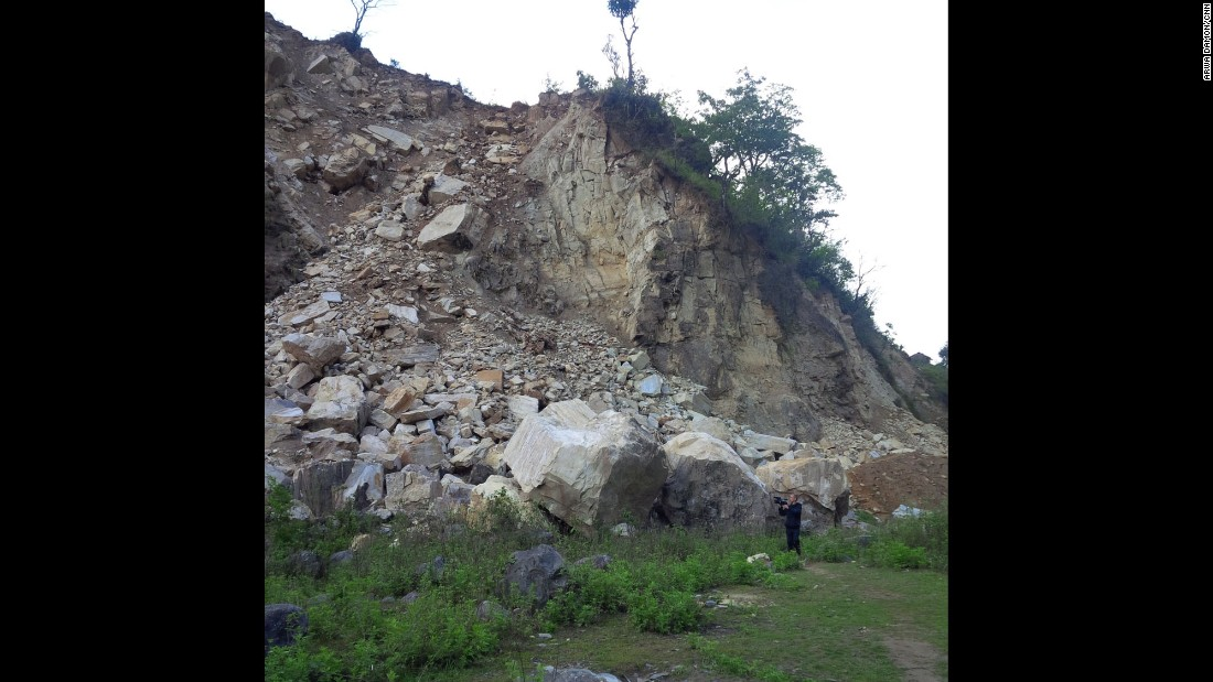 NEPAL: CNN cameraman Brice Laine films boulders from a landslide that are blocking the road -- caused by a devastating magnitude 7.8 earthquake on April 25th. Photo by CNN's Arwa Damon.