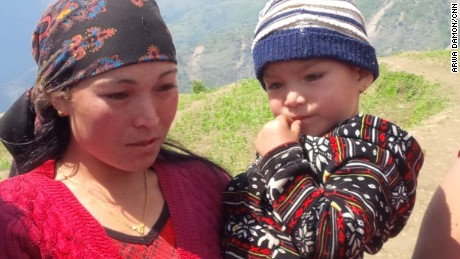 Santi Sunar, Sunil's cousin, and her son Ayus survived the earthquake -- but their village is now a sea of debris.