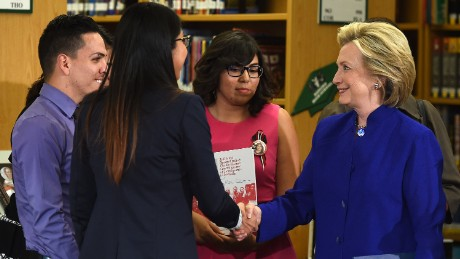 Democratic presidential candidate and former U.S. Secretary of State Hillary Clinton (R) shakes hands with students after speaking at Rancho High School on May 5, 2015 in Las Vegas, Nevada. Clinton said that any immigration reform would need to include a path to 'full and equal citizenship.'