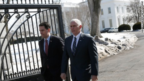 Gov. Walker (left) and Gov. Pence (right) depart the White House after President Obama addresses members of the National Governors Association on February 23, 2015 in Washington, DC.