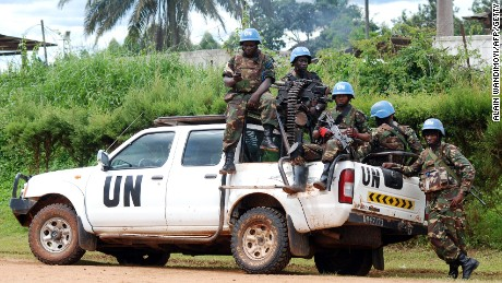 File: Blue helmet members of the United Nations Organization Stabilization Mission in the Democratic Republic of Congo sit on the back of a UN pickup truck on October 2014.