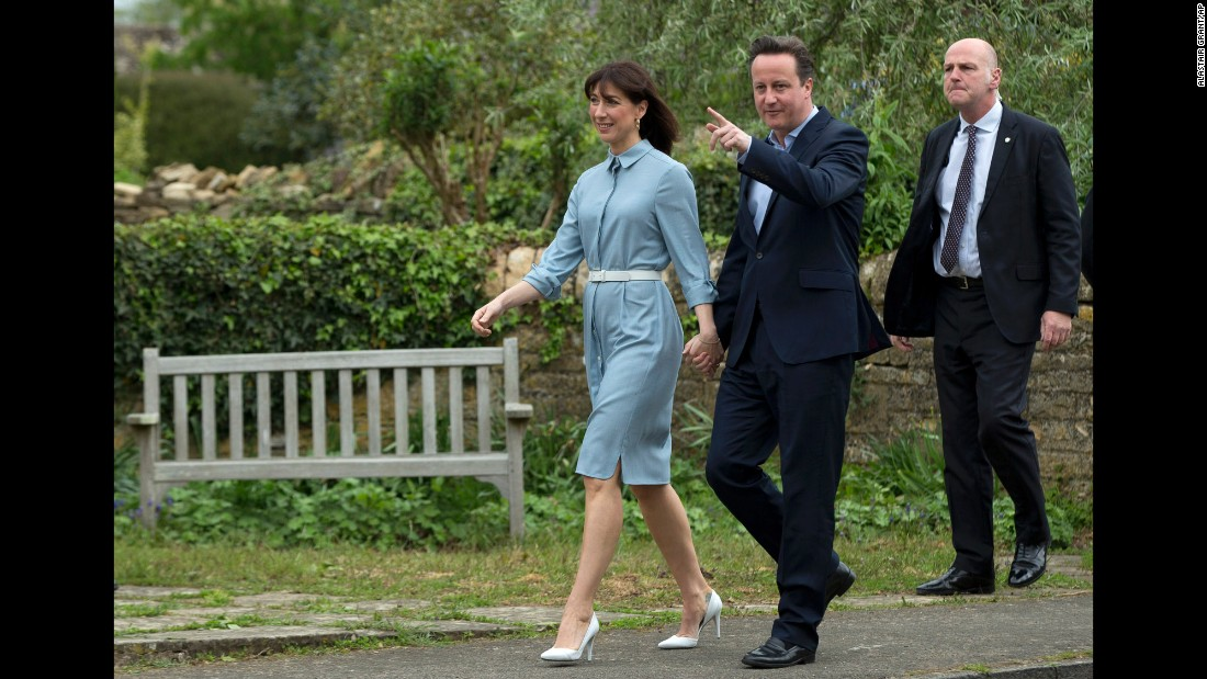 British Prime Minister David Cameron, leader of the Conservative Party, and his wife, Samantha, arrive at a polling station in Spelsbury, Oxfordshire, England.