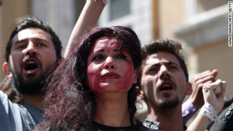 Afghan artists on April 27, 2015 perform a role play to depict the lynching of Afghan woman Farkhunda, 27, who was attacked by an angry mob, in Kabul. Farkhunda was beaten with sticks and stones, thrown from a roof, before being run over by a car outside a mosque in Kabul on March 19. The mob then set her body ablaze and dumped it in a river as police allegedly looked on. AFP PHOTO / SHAH Marai (Photo credit should read SHAH MARAI/AFP/Getty Images)