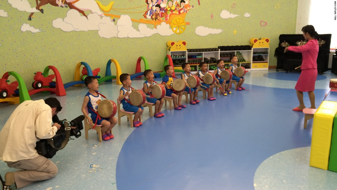 Young boys practice a drum routine that they will perform during International Children's Day in June.