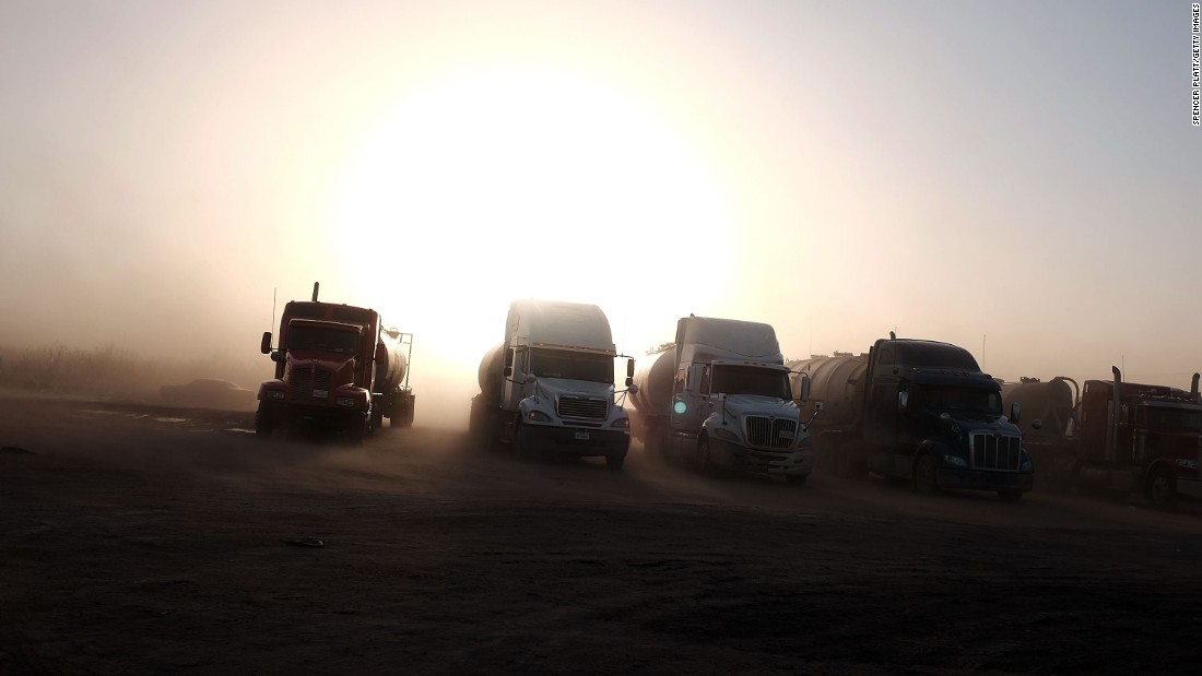 Trucks used in the fracking industry sit at a truck stop in Odessa, Texas, on February 4.