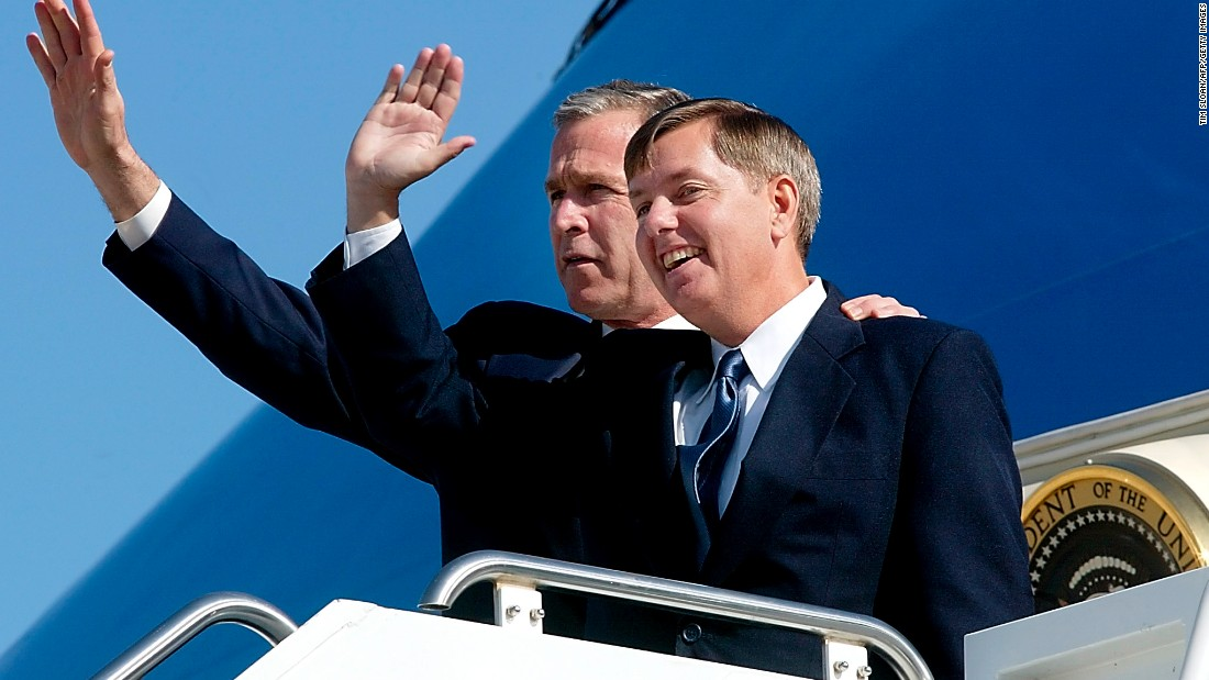 U.S. President George W. Bush, left, stands with Graham on the steps of Air Force One at the airport in Greenville, South Carolina, in March 2002.