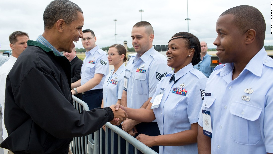Greeting military personnel at Offutt Air Force Base near Omaha, Nebraska, on August 13, 2012.