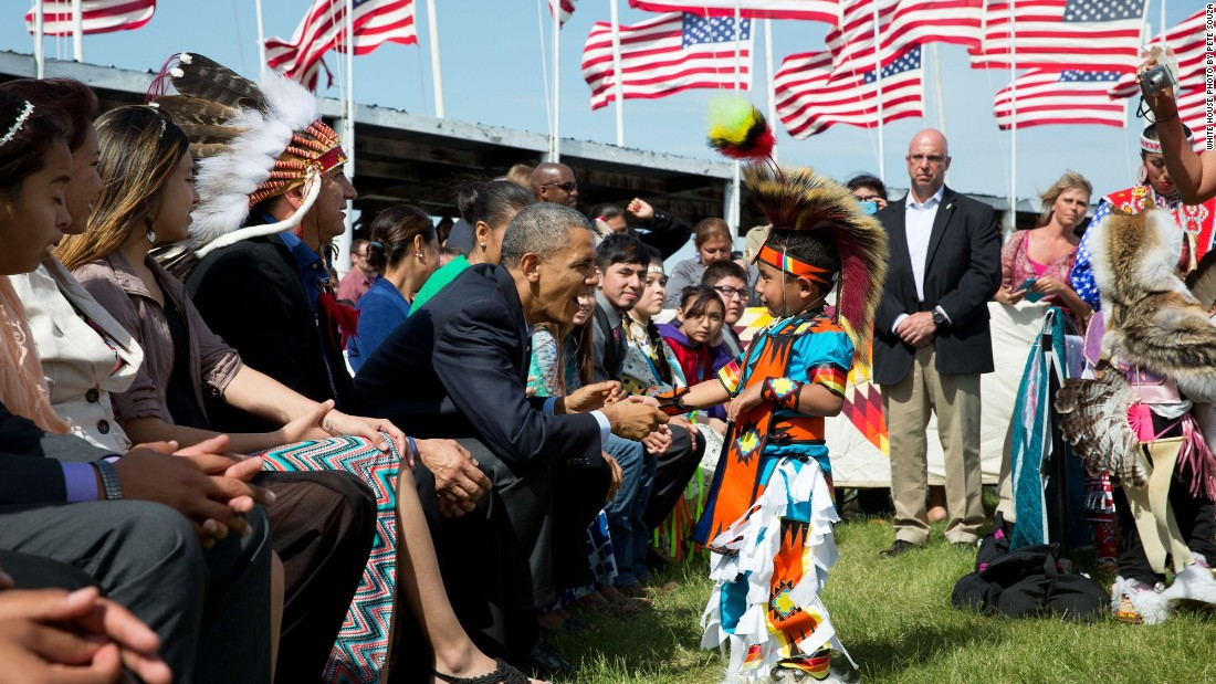 Greeting a young boy during a Flag Day celebration on June 13, 2014, at the Standing Rock Sioux Tribe Reservation in Cannon Ball, North Dakota. Cannon Ball is south of Bismarck.
