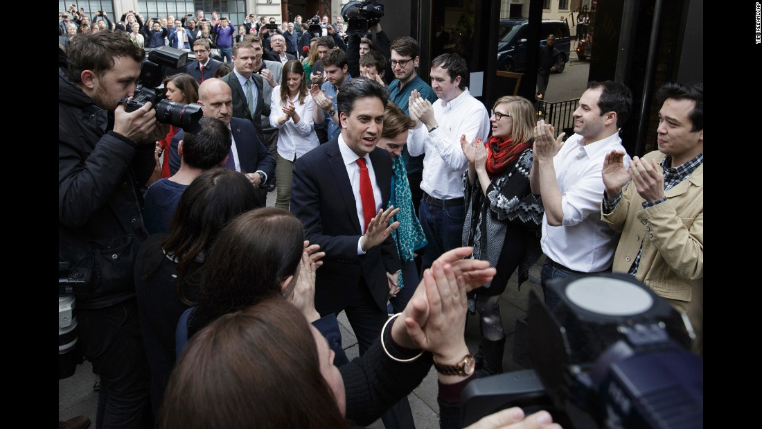 "Labour Party leader Ed Miliband arrives with his wife Justine at the Labour Party headquarters in London on May 8. Miliband retained his seat during the election but said it was a ""clearly disappointing night."""