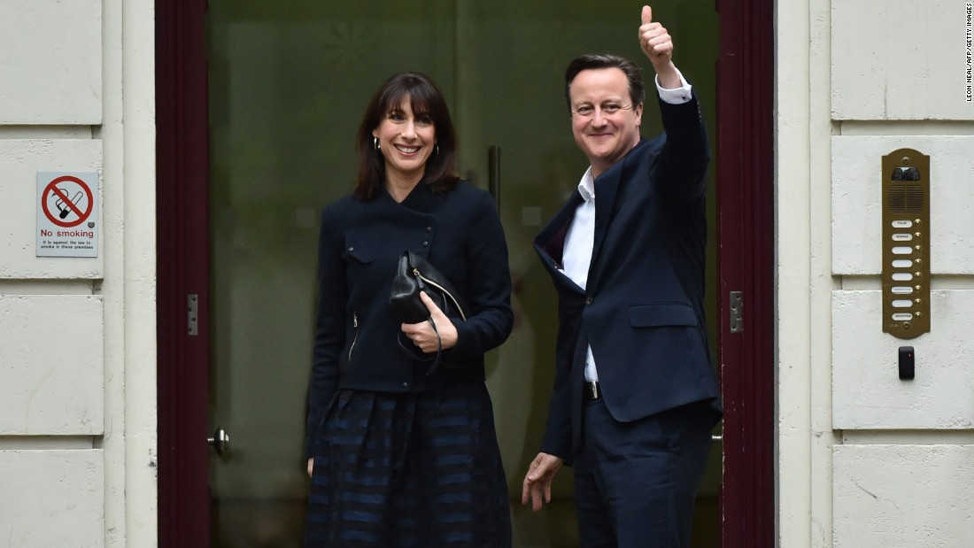 British Prime Minister David Cameron and his wife, Samantha, arrive at the Conservative Party headquarters in London on Friday, May 8. Cameron stays in power with his party, the Conservatives, stronger than at the last election in 2010.