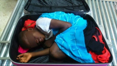 A boy was found in a suitcase wheeled by a Moroccan woman.