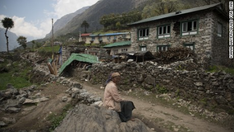 KHUMJUNG DISTRICT, NEPAL | 2015-05-04 | An old woman sits in front of her destructed house in Kyongma village, that was hit badly by the earthquake.