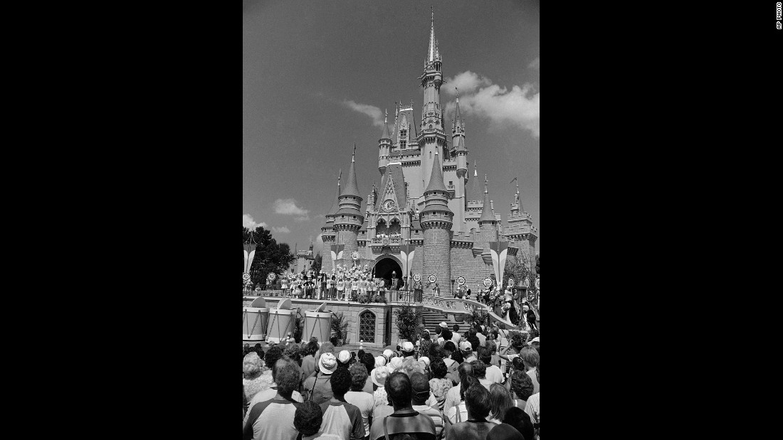 A crowd in Orlando waits for Walt Disney World's Main Street to open in October 1971. The park cost an estimated $400 million to build and now attracts around 25 million visitors annually. When Disney World opened in 1971, the price for admission was $3.50. A single-day ticket now is $105 for anyone over 10 years old.
