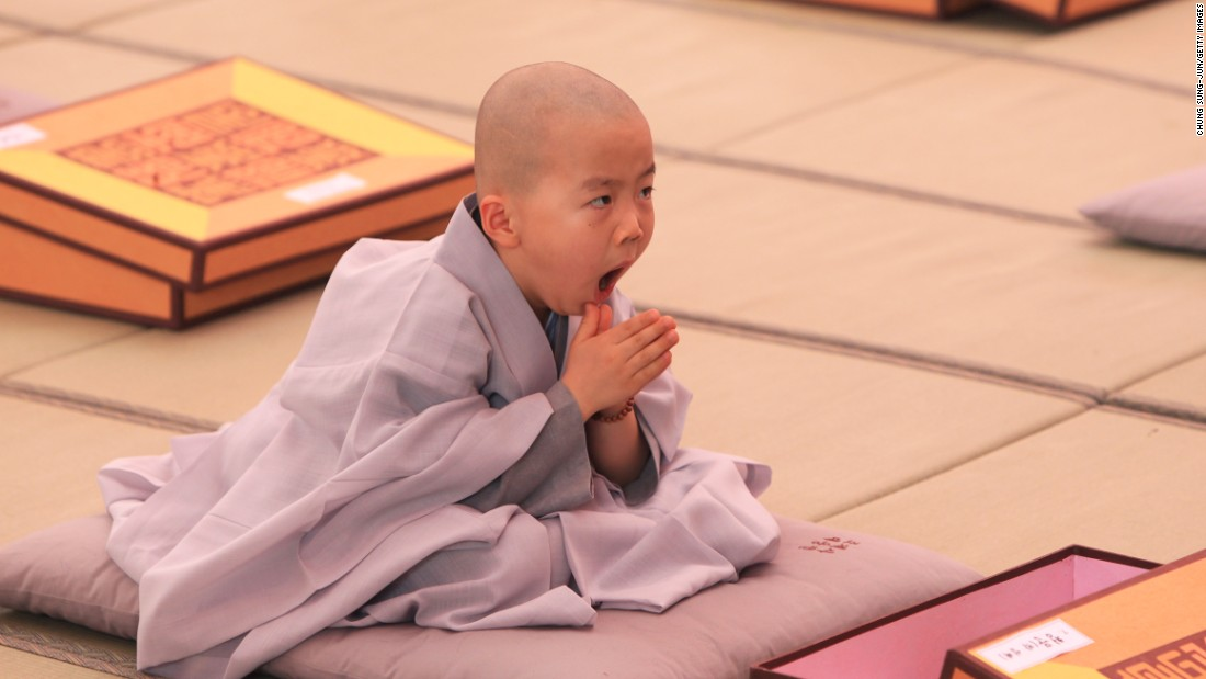 MAY 11 -- SEOUL, SOUTH KOREA: A child looks a little sleepy while attending the 'Children Becoming Buddhist Monks' ceremony at a Chogye temple ahead of Buddha's birthday. The children will stay at the temple to learn about Buddhism for 14 days. Buddha was born approximately 2,559 years ago, and although the exact date is unknown, Buddha's official birthday is celebrated on the full moon in May in South Korea, which is on May 25 this year.