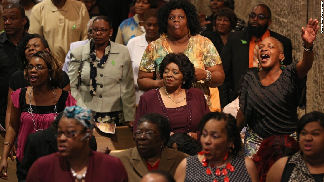 Church members pray at a Baptist church in Baltimore. Black Protestants make up 6.5% of the American population, according to the Pew Research Center study.