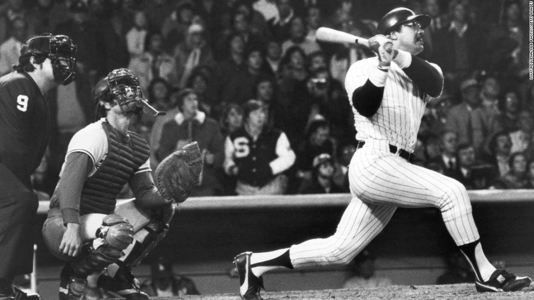 "Reggie Jackson of the New York Yankees hits his third home run of the game on October 18, 1977, leading the Yankees to a World Series win over the Los Angeles Dodgers. Jackson had a .357 batting average over the 27 World Series games throughout his career, earning him the nickname ""Mr. October."" Jackson and the Yankees would repeat as World Series champions the following year."