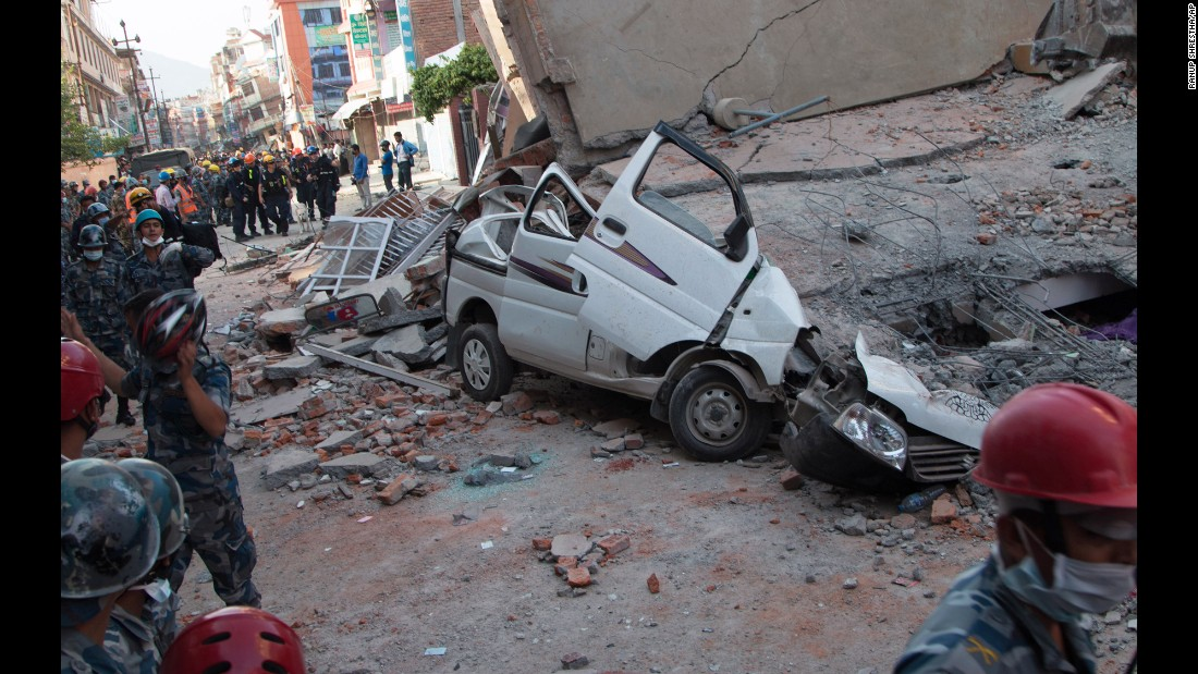 A car is smashed under the weight of a collapsed building in Kathmandu on May 12.