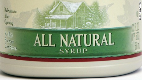 "A jug of Log Cabin syrup is seen in Montpelier, Vt., Thursday, Sept. 9, 2010.  Vermont officials are taking issue with the new Log Cabin ""All Natural Syrup"" containing ingredients that may not be. U.S. Rep. Peter Welch wants the U.S. Food and Drug Administration to investigate whether the company is violating FDA labeling laws. A Log Cabin representative is defending the labeling as proper.  The new product, which is being sold in jug containers similar to those used by Vermont maple producers, contains xanthan gum, caramel color and citric acid.  (AP Photo/Toby Talbot)"