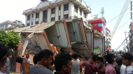 After a major earthquake hit Nepal on May 12, three houses collapsed near Kathmandu's New Bus Park. Army and police began rescue operations.