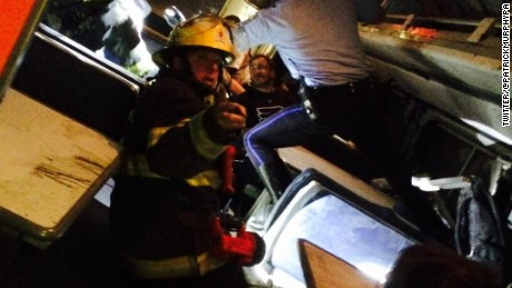 "Former U.S. Rep. Patrick Murphy tweeted he was aboard the train when it crashed. ""Helping others,"" he said. ""Pray for those injured."" Later he shared this photo that showed a firefighter inside the train."
