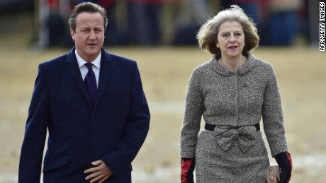 (FILES) A file picture taken on October 21, 2014, shows British Prime Minister David Cameron (L) and Home Secretary Theresa May attending a ceremonial welcome in London. David Cameron's announcement that he would not seek a third term sparked heated debate on Tuesday March 24, 2015, over whether he was being laudably honest or had undermined his authority just weeks before an election. AFP PHOTO / TOBY MELVILLE/FILESTOBY MELVILLE/AFP/Getty Images