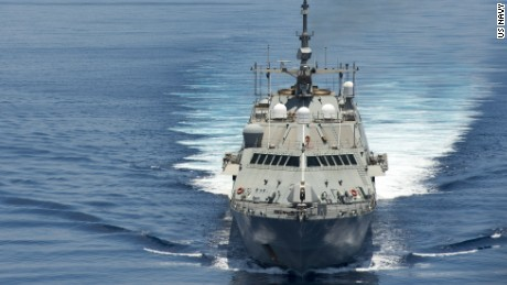The U.S. is considering deploying aircraft and ships to contest Chinese claims to disputed islands in the South China Sea, U.S. officials said Wednesday, May 13, 2015. The USS Fort Worth conducts patrols in the South China Sea as the Chinese frigate Yancheng trails it. Spec 2nd Class Conor Minto/US Navy