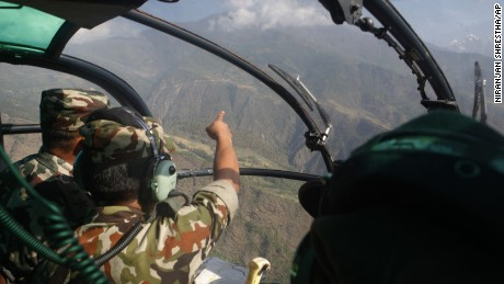 Nepalese army members search for a missing U.S. Marine helicopter in the Dolakha district of Nepal on Thursday, May 14.