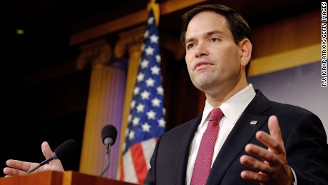 en. Marco Rubio (R-FL) reacts to U.S. President Barack Obama's announcement about revising policies on U.S.-Cuba relations on December 17, 2014 in Washington, DC. Rubio called the President a bad negotiator and criticized what he claimed was a deal with no democratic advances for Cuba.